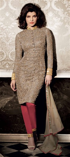 449602 Beige and Brown  color family Bollywood Salwar Kameez in Net fabric with Machine Embroidery work .