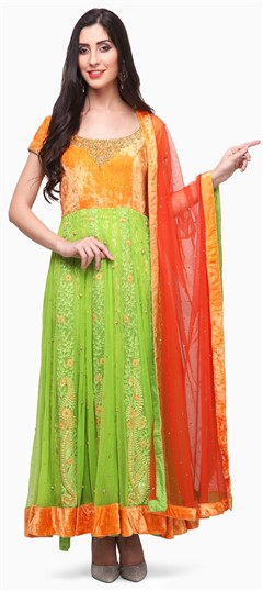 475382 Green, Orange  color family Anarkali Suits in Net, Velvet fabric with Lace, Machine Embroidery, Sequence, Stone, Valvet work .