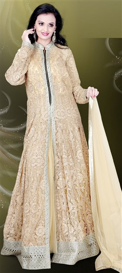 478867 Beige and Brown  color family gown in Net, Silk fabric with Machine Embroidery, Stone, Thread work .