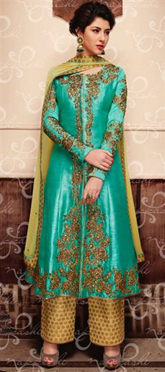 489431 Green  color family Party Wear Salwar Kameez in Banarasi, Silk fabric with Lace, Machine Embroidery, Stone, Zari work .