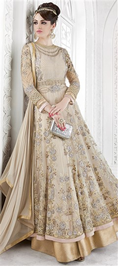 491554 Beige and Brown  color family Anarkali Suits in Net fabric with Machine Embroidery,Stone,Thread,Zari work .