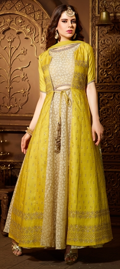 904287 Beige and Brown, Yellow  color family Party Wear Salwar Kameez in Net, Raw Silk fabric with Kasab, Sequence, Stone work .