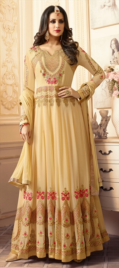 906685 Beige and Brown  color family Bollywood Salwar Kameez in Faux Georgette fabric with Bugle Beads, Lace, Machine Embroidery, Thread, Zari work .