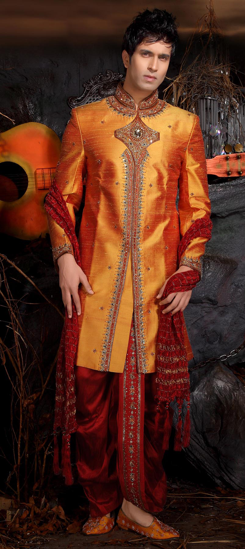 11023: Orange,Red and Maroon color family stitched Dhoti Sherwani .